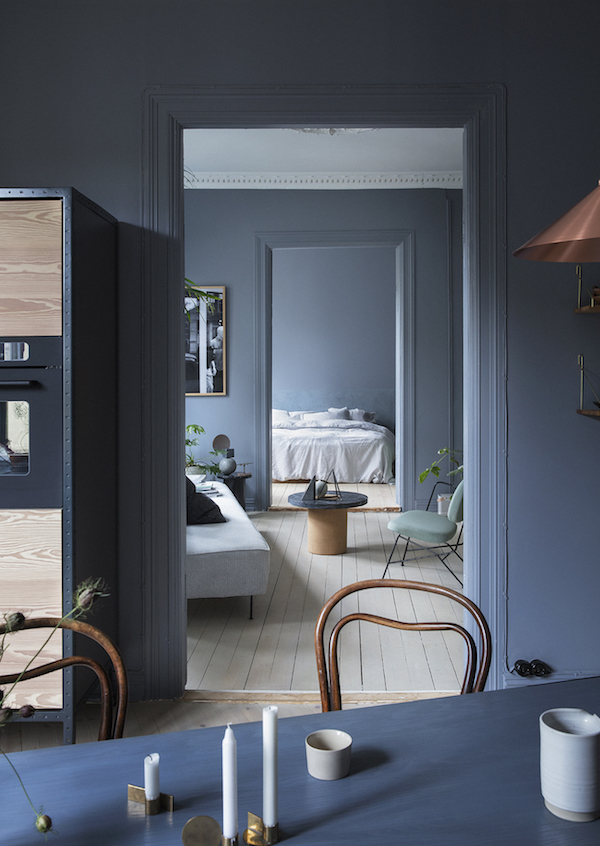 An apartment dominated by a smooky blue color