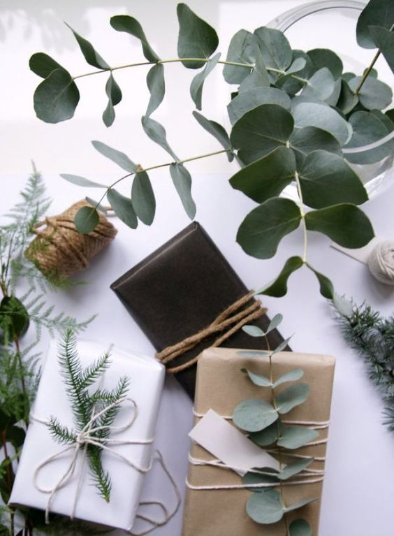 wrapping gift with craft paper and natural element like eucalyptus